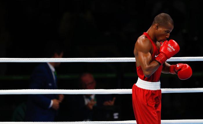 O lutador brasileiro Robson Conceição derrotou o francês Sofiane Oumiha e garantiu o ouro na categoria peso ligeiro, até 60 quilos nas Olimpíadas do Rio de Janeiro. (Crédito: Fernando Frazão/Agência Brasil)